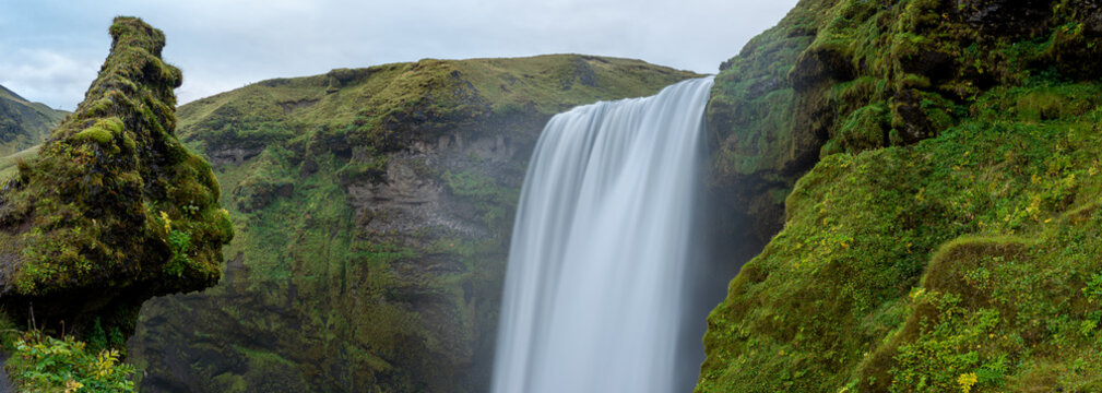 A panoramic view of skogafoss waterfall in iceland