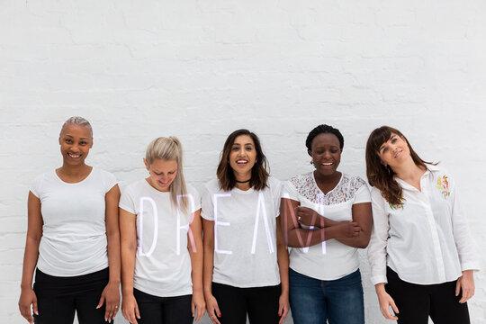 Diverse women smiling together