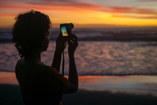 A girl make a photo by digital photo camera