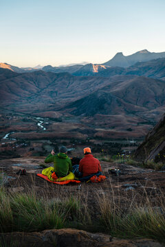 Two hikers admiring lansacape at fisrt our in the morning after bivouaking under the stars