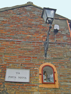 Italy, Marche, Mondolfo, Virgin Mary with the Child decoration in an old house
