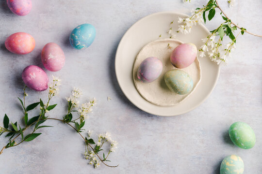 Colorful dyed eggs on plates