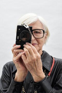 Senior Woman Taking Photo