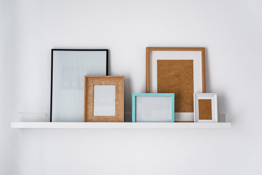 Rack of a modern flat with empty picture frames