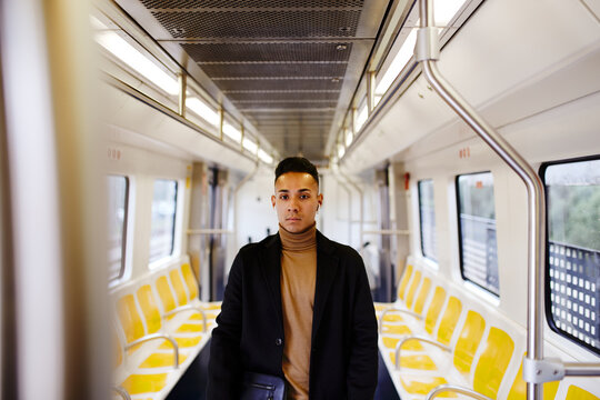 Young man riding a train to work