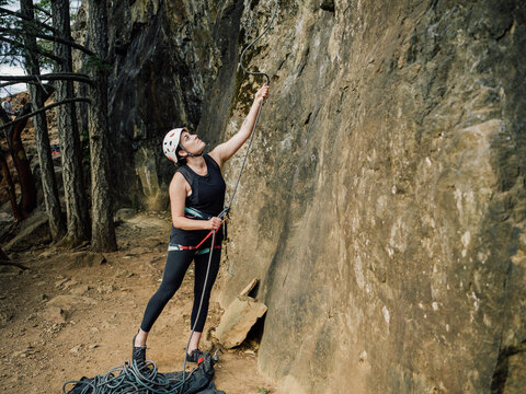 Woman belaying with helmet on
