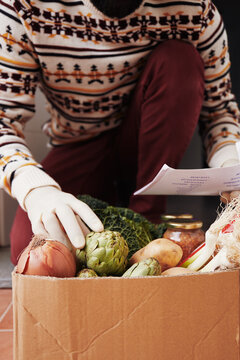 Man checking a grocery list for his delivery