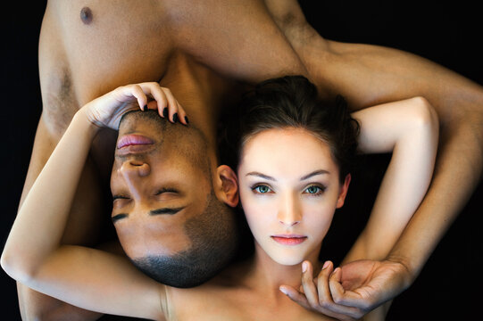 Portrait of an international couple on the black background