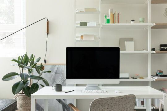 minimal home office with imac in bright organized studio