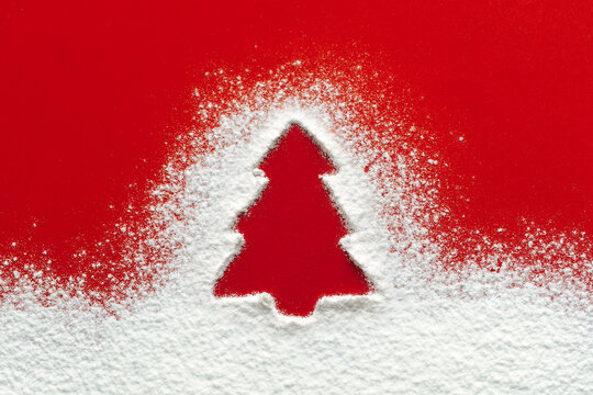 Christmas tree floury snow shape, red paper background