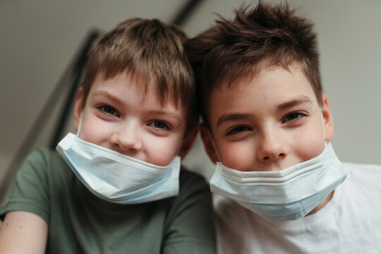 Young brothers in protective medical masks.