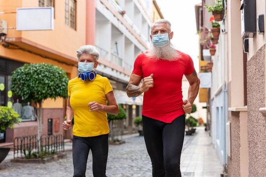 Senior couple running around town