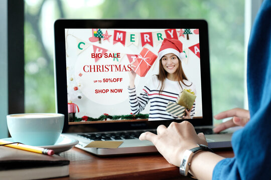 Christmas online sale, Woman using laptop computer for shopping online discount store in Christmas season, digital marketing, e commerce