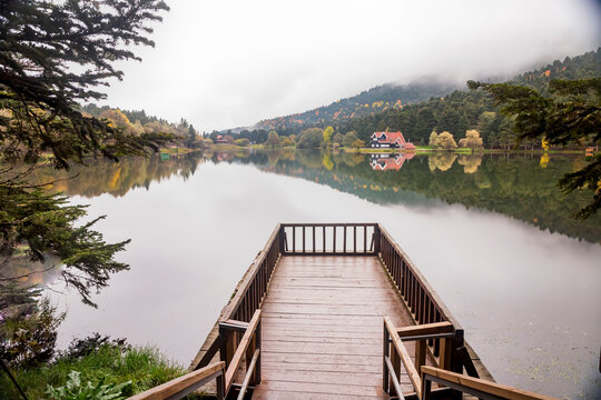 Autumn wooden Lake house inside forest in Bolu Golcuk National Park, Turkey wallpaper