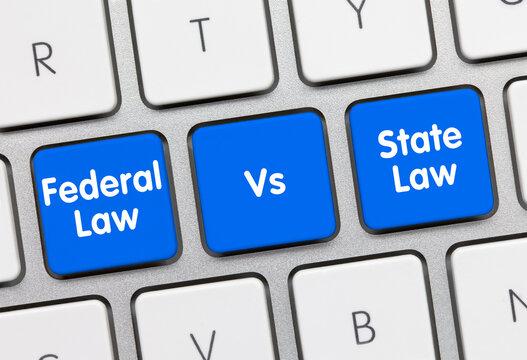 Federal law vs State law - Inscription on Blue Keyboard Key.