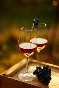 Two glasses of rose wine on a wooden crate, top view