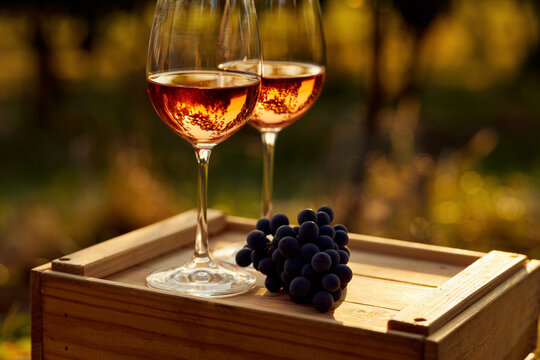 Close up of two glasses of rose wine on a wooden crate