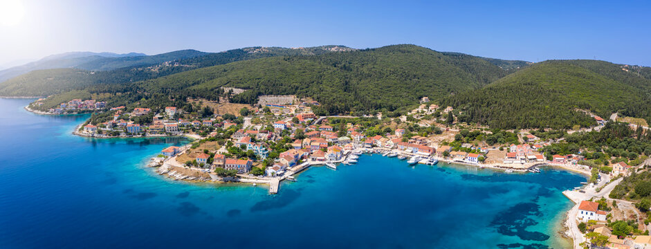 Panorama of the picturesque village of Fiskardo, Kefalonia, Greece, a sailors marina with idyllic atmosphere and Bars and Taverns by the sea