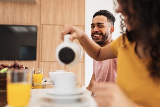 Latin American family having breakfast at home