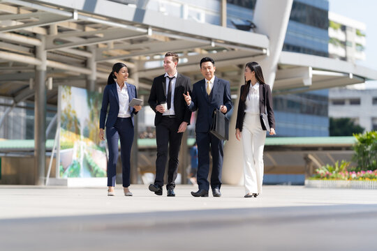 Business people walking and talk to each other