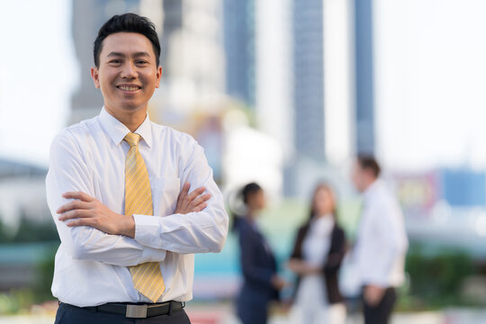 Portrait of successful businessman standing with arms crossed