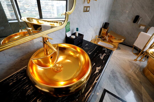Gold-plated bathroom sink, toilet and bathtub are seen in the Dolce Hanoi Golden Lake luxury hotel in Hanoi