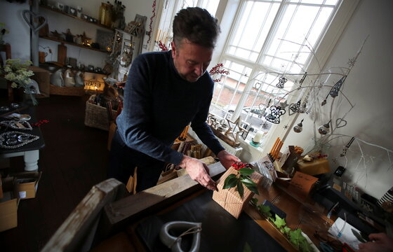 Paul, owner of Me and Mr Jones Gift Shop, prepares his shop for Christmas and reopening after lockdown, amid the coronavirus disease (COVID-19) outbreak, in Frodsham