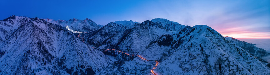 Evening mountains landscape with a road to the Chimbulak ski resort. Panoramic photo. Almaty Kazakhstan