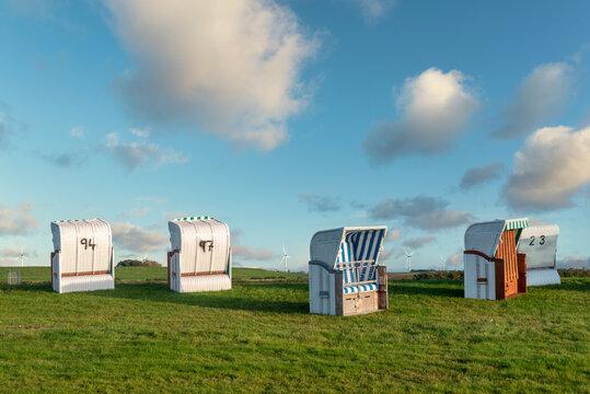 Canopied wicker beach chairs on the beach Dockkoogspitze in Husum