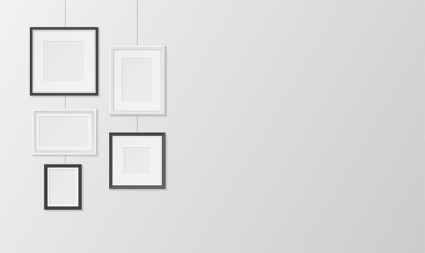 Pictures, photos frames white and black design hanging on wall horizontal banner. Passepartout.