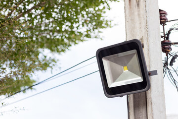A modern street LED lighting pole. Urban electro-energy technologies. Poles on the road with LED light. Outdoor lighting strong LED lamp.  Fotomurales