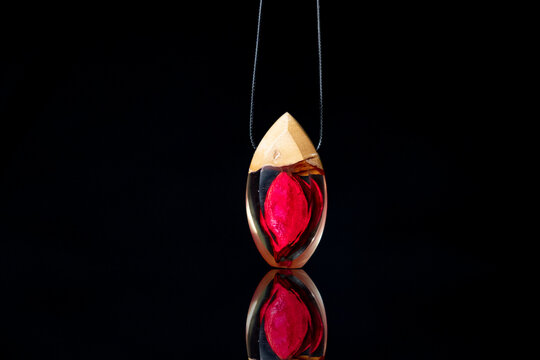 Gift necklace model of rose leaf with epoxy and wood