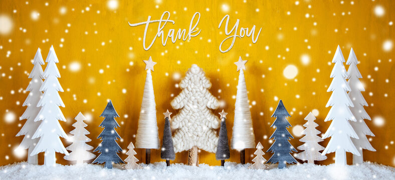 Banner Of Christmas Trees With English Calligraphy Thank You. Yellow Wooden Rustic Background With Snow And Snowflakes. Christmas Decoration With Stars.