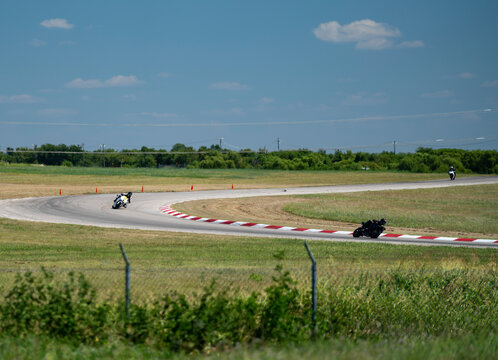 Lone motorcycle rider leaning heavily into the turn