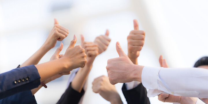 Different business people group raising hands