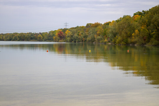 Row of yellow buoys floating in a placid lake