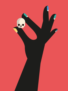 Hand holding a small skull