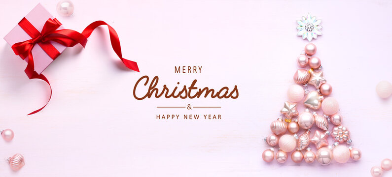 Art Christmas tree decoration and gift box on light background