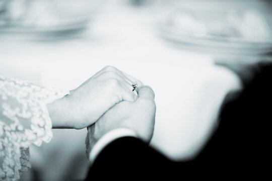 Cropped Image Of Couple Holding Hands During Wedding Ceremony