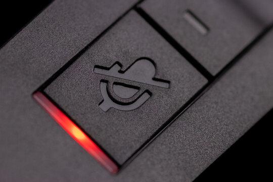 Mute button on a communication headset