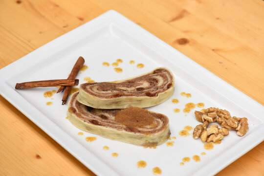 Walnut bread roll on wooden background