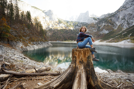 beautiful girl sitting on a stump