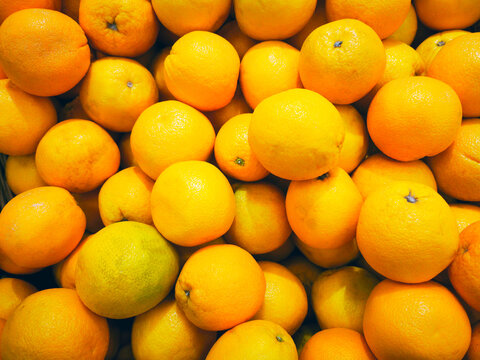 Group of chewy oranges in the supermarket, Background orange, Fresh oranges from the farm garden, lots of orange in the market square. Healthy food concept.