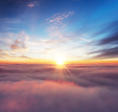 Rising sunset above the clouds