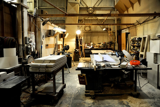 Cluttered and busy woodworking shop