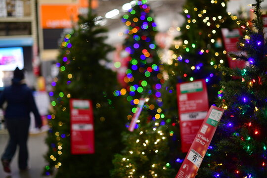 A shopper walks past artificial Christmas trees for sale at a Home Depot store in Wilmington