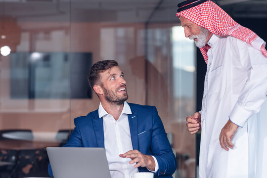 Mature Middle Eastern businessman wearing ghoutra in meeting