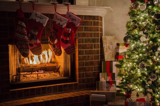 Christmas Stockings Hanging On Mantelpiece At Home