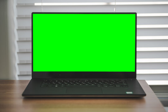 Dell Laptop w/Green Screen on Wood Table