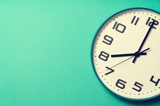 Retro clock on green table background, vintage style